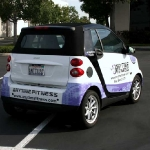 4_vehiclewrap_smartcar_anytimefitness_iconography