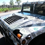 8_theonedollardifference_hummer_vehiclewrap_iconography
