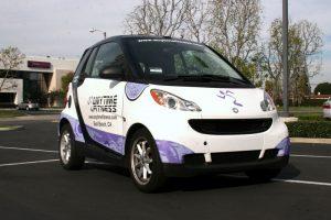 2_vehiclewrap_smartcar_anytimefitness_iconography