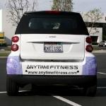 1_vehiclewrap_smartcar_anytimefitness_iconography