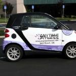 3_vehiclewrap_smartcar_anytimefitness_iconography