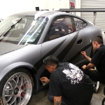 10_competitionmotorsports_porsche_racecargraphics_install_iconography_0